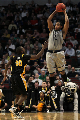 CHICAGO, IL - MARCH 18: Austin Freeman #15 of the Georgetown Hoyas looks to pass against Ed Nixon #50 of the Virginia Commonwealth Rams in the first half during the second round of the 2011 NCAA men's basketball tournament at the United Center on March 18