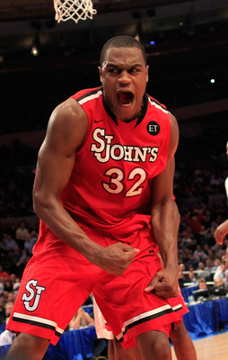 NEW YORK, NY - MARCH 10: Justin Brownlee #32 of the St. John's Red Storm reacts after a play in the second half against the Syracuse Orange during the quarterfinals of the 2011 Big East Men's Basketball Tournament presented by American Eagle Outfitters  a