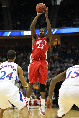 TULSA, OK - MARCH 18:  John Holland #23 of the Boston University Terriers goes up for a shot against the Kansas Jayhawks during the second round of the 2011 NCAA men's basketball tournament at BOK Center on March 18, 2011 in Tulsa, Oklahoma.  (Photo by Ro