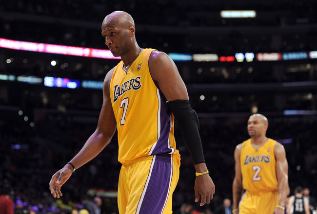 LOS ANGELES, CA - APRIL 12:  Lamar Odom #7 and Derek Fisher #2 of the Los Angeles Lakers leave the court during the game against the San Antonio Spurs at Staples Center on April 12, 2011 in Los Angeles, California.  NOTE TO USER: User expressly acknowledg