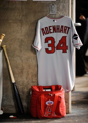 LOS ANGELES, CA - MAY 23:  The baseball jersey of deceased pitcher Nick Adenhart #34 of the Los Angeles Angels of Anaheim hangs in the Angels dugout during the baseball game against the Los Angeles Dodgers at Dodgers Stadium on May 23, 2009 in Los Angeles