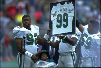 6 SEP 1992:  PHILADELPHIA EAGLES DEFENSIVE LINEMAN REGGIE WHITE #92 ALONG WITH LINEBACKER SETH JOYNER #59, HOLD UP FORMER EAGLES LINEMAN JEROME BROWN #99 RETIRED JERSEY PRIOR TO THE EAGLES 15-13 WIN OVER THE NEW ORLEANS SAINTS AT VETERANS STADIUM IN PHILA