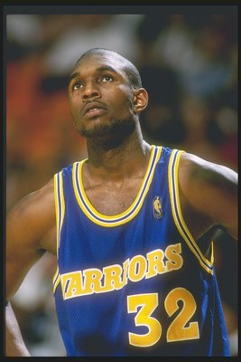12 Mar 1997: Forward Joe Smith of the Golden State Warriors stands on the court during a game against the Los Angeles Lakers at the Great Western Forum in Inglewood, California. The Lakers won the game 109-101.