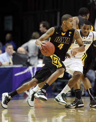 INDIANAPOLIS, IN - MARCH 10:  Roy Devyn Marble #4 of the Iowa Hawkeyes drives against the Michigan State Spartans during the first round of the 2011 Big Ten Men's Basketball Tournament at Conseco Fieldhouse on March 10, 2011 in Indianapolis, Indiana. Mich