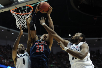 ANAHEIM, CA - MARCH 26:  Derrick Williams #23 of the Arizona Wildcats goes up for a rebound against Jamal Coombs-McDaniel #4 and Charles Okwandu #35 of the Connecticut Huskies during the west regional final of the 2011 NCAA men's basketball tournament at