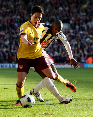 WEST BROMWICH, ENGLAND - MARCH 19:  Samir Nasri of Arsenal (L) in action with Marc-Antoine Fortune of WBA at The Hawthorns on March 19, 2011 in West Bromwich, England.  (Photo by Scott Heavey/Getty Images)