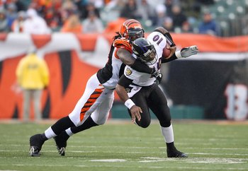 CINCINNATI - NOVEMBER 30:  Rashad Jeany #93 of the Cincinnati Bengals tackles quarterback Troy Smith #16 of the Baltimore Raven during their NFL game on November 30, 2008 at Paul Brown Stadium in Cincinnati, Ohio. The Ravens defeated the Bengals 34-3.(Pho