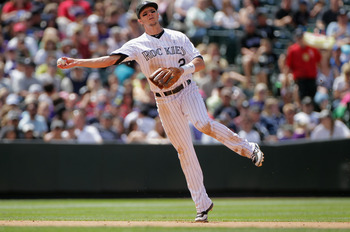 DENVER, CO - JUNE 19:  Shortstop Troy Tulowitzki #2 of the Colorado Rockies fields a gound ball and throws out the runner against the Detroit Tigers at Coors Field on June 19, 2011 in Denver, Colorado. The Tigers defeated the Rockies 9-1.  (Photo by Doug 