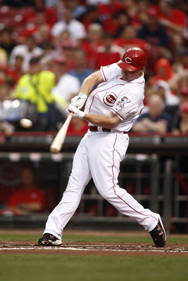 CINCINNATI, OH - JUNE 18:   Jay Bruce #32 of the Cincinnati Reds singles to right field during the game against the Toronto Blue Jays on June 18, 2011 at Great American Ball Park in Cincinnati, Ohio.  The Toronto Blue Jays defeated the Cincinnati Reds 4-0