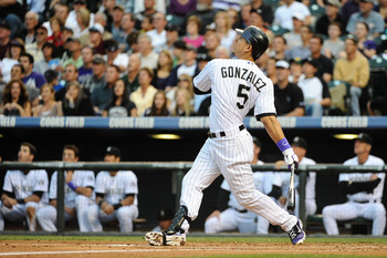 DENVER, CO - JUNE 17:  Carlos Gonzalez #5 of the Colorado Rockies watches his hit during the game against the Detroit Tigers at Coors Field on June 17, 2011 in Denver, Colorado.  (Photo by Garrett W. Ellwood/Getty Images)