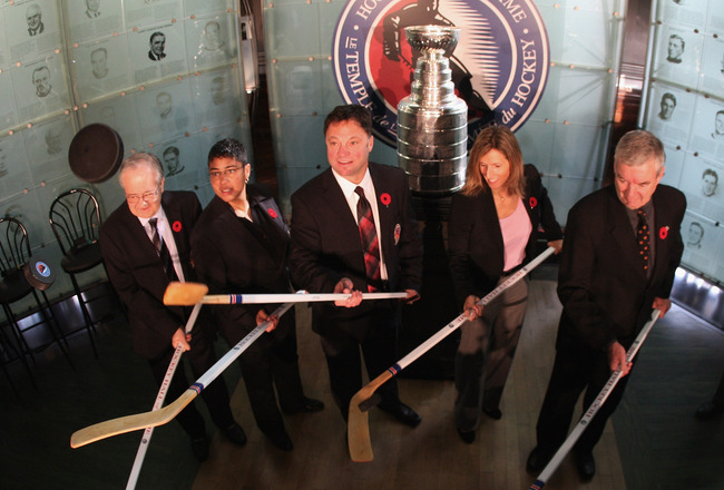 TORONTO, ON - NOVEMBER 08:  (L-R) , Jimmy Devellano Angela James, Dino Ciccarelli, Cammi Granato,  and Bob Seaman (representing Doc Seaman), appear at a media opportunity prior to their induction ceremony to the Hockey Hall of Fame on November 8, 2010 in