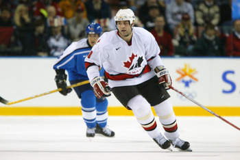 20 Feb 2002: Eric Lindros #88 of Canada in action during the men's quarterfinals against Finland at the Salt Lake City Winter Olympic Games at the E Center in Salt Lake City, Utah. DIGITAL IMAGE. Mandatory Credit:   Robert Laberge/Getty Images
