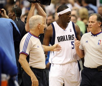 Josh Howard speaks with some NBA officials.