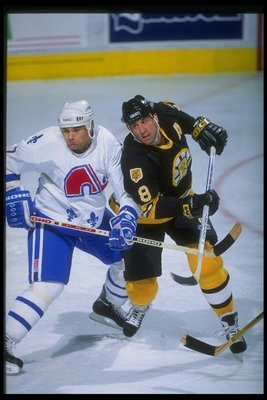 1993-1994:  Rightwinger Cam Neely of the Boston Bruins and defenseman Curtis Leschyshyn of the Quebec Nordiques tangle up during a game at the Quebec Coliseum in Quebec City, Quebec.  Mandatory Credit: Robert Laberge  /Allsport