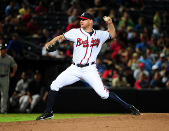 ATLANTA - JUNE 21: Jonny Venters #39 of the Atlanta Braves pitches against the Toronto Blue Jays at Turner Field on June 21, 2011 in Atlanta, Georgia. (Photo by Scott Cunningham/Getty Images)