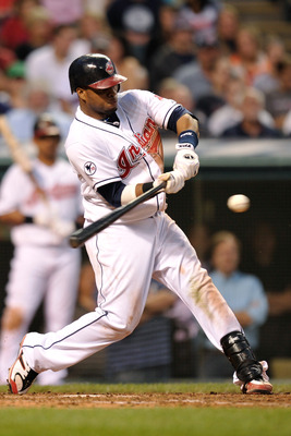 CLEVELAND, OH - JUNE 20:  Carlos Santana #41 of the Cleveland Indians connects for a single against the Colorado Rockies at Progressive Field on June 20, 2011 in Cleveland, Ohio. Santana also had a home run in Cleveland's 8-7 loss to Colorado.  (Photo by