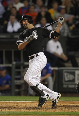 CHICAGO, IL - JUNE 22: Paul Konerko #14 of the Chicago White Sox hits the ball against the Chicago Cubs at U.S. Cellular Field on June 22, 2011 in Chicago, Illinois. The White Sox defeated the Cubs 