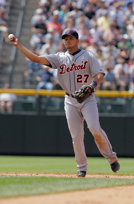 DENVER, CO - JUNE 19:  Shortstop Jhonny Peralta #27 of the Detroit Tigers throws out a runner against the Colorado Rockies at Coors Field on June 19, 2011 in Denver, Colorado. The Tigers defeated the Rockies 9-1.  (Photo by Doug Pensinger/Getty Images)