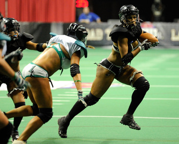 LAS VEGAS, NV - FEBRUARY 06:  Zipphora Chase #19 of the Los Angeles Temptation runs for yardage against the Philadelphia Passion during the Lingerie Football League's Lingerie Bowl VIII at the Thomas & Mack Center February 6, 2011 in Las Vegas, Nevada. Lo