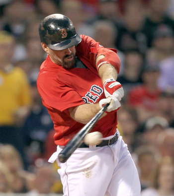 BOSTON, MA  - JUNE 17:  Kevin Youkillis #20 of the Boston Red Sox knocks in two runs in the third inning against the Milwaukee Brewers at Fenway Park on June 17, 2011 in Boston, Massachusetts.  (Photo by Jim Rogash/Getty Images)