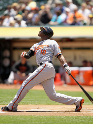 OAKLAND, CA - MAY 29:  Adam Jones #10 of the Baltimore Orioles in action against the Oakland Athletics at Oakland-Alameda County Coliseum on May 29, 2011 in Oakland, California.  (Photo by Ezra Shaw/Getty Images)