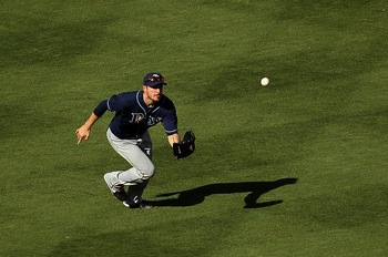 MIAMI GARDENS, FL - MAY 21: Matt Joyce #20 of the Tampa Bay Rays makes a catch during a game against the Florida Marlins at Sun Life Stadium on May 21, 2011 in Miami Gardens, Florida. (Photo by Mike Ehrmann/Getty Images)