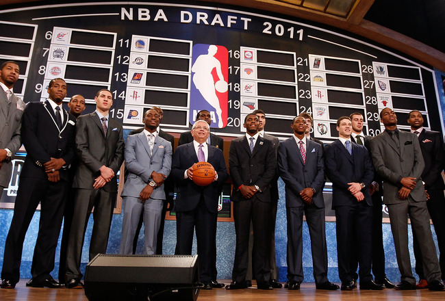 NEWARK, NJ - JUNE 23:  The 2011 Draft class including Kyrie Irving, Derrick Williams, Enes Kanter, Jonas Valanciunas, Brandon Knight, Jimmer Fredette and Kemba Walker pose for a group photo with NBA Commissioner David Stern (C) during the 2011 NBA Draft a