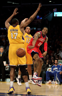 LOS ANGELES, CA - FEBRUARY 26:  Andre Iguodala #9 of the Philadelphia 76ers passes the ball around Andrew Bynum #17 of the Los Angeles Lakers in the first half at Staples Center on February 26, 2010 in Los Angeles, California. NOTE TO USER: User expressly