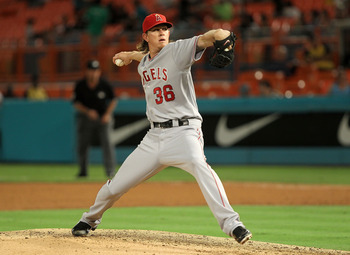 MIAMI GARDENS, FL - JUNE 20:  Jared Weaver #36 of the Los Angeles Angels of Anaheim pitches during a game against the Florida Marlins at Sun Life Stadium on June 20, 2011 in Miami Gardens, Florida.  (Photo by Mike Ehrmann/Getty Images)