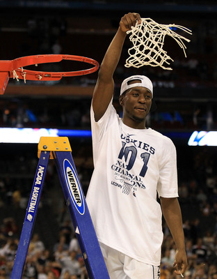 HOUSTON, TX - APRIL 04:  Kemba Walker #15 of the Connecticut Huskies cuts down the net after defeating the Butler Bulldogs to win the National Championship Game of the 2011 NCAA Division I Men's Basketball Tournament by a score of 53-41 at Reliant Stadium