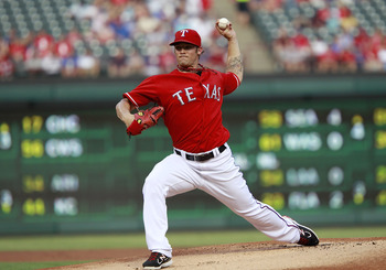 ARLINGTON, TX - JUNE 21:  C.J. Wilson #36 of the Texas Rangers throws the first pitch of the game against the Houston Astros at Rangers Ballpark in Arlington on June 21, 2011 in Arlington, Texas.  (Photo by Rick Yeatts/Getty Images)