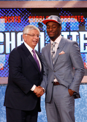 NEWARK, NJ - JUNE 23:  Kemba Walker from UCONN greets NBA Commissioner David Stern after he was selected #9 overall by the Charlotte Bobcats in the first round during the 2011 NBA Draft at the Prudential Center on June 23, 2011 in Newark, New Jersey.  NOT