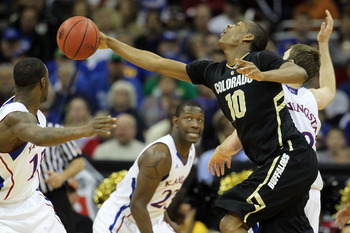 KANSAS CITY, MO - MARCH 11:  Alec Burks #10 of the Colorado Buffaloes reaches for the ball during their semifinal game against the Kansas Jayhawks in the 2011 Phillips 66 Big 12 Men's Basketball Tournament at Sprint Center on March 11, 2011 in Kansas City