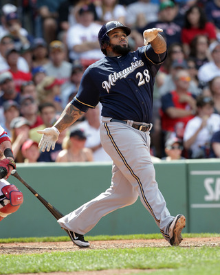 BOSTON, MA  - JUNE 19: Prince Fielder #28 of the Milwaukee Brewers connects for a home run against the Boston Red Sox at Fenway Park on June 19, 2011 in Boston, Massachusetts.  (Photo by Jim Rogash/Getty Images)