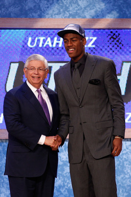 NEWARK, NJ - JUNE 23:  Alec Burks from the Colorado Buffalos greets NBA Commissioner David Stern after he was selected #12 overall by the Utah Jazz in the first round during the 2011 NBA Draft at the Prudential Center on June 23, 2011 in Newark, New Jerse