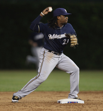 CHICAGO, IL - JUNE 14:  Rickie Weeks #23 of the Milwaukee Brewers throws to 1st base against the Chicago Cubs at Wrigley Field on June 14, 2011 in Chicago, Illinois. The Cubs defeated the Brewers 5-4 in 10 innings.  (Photo by Jonathan Daniel/Getty Images)