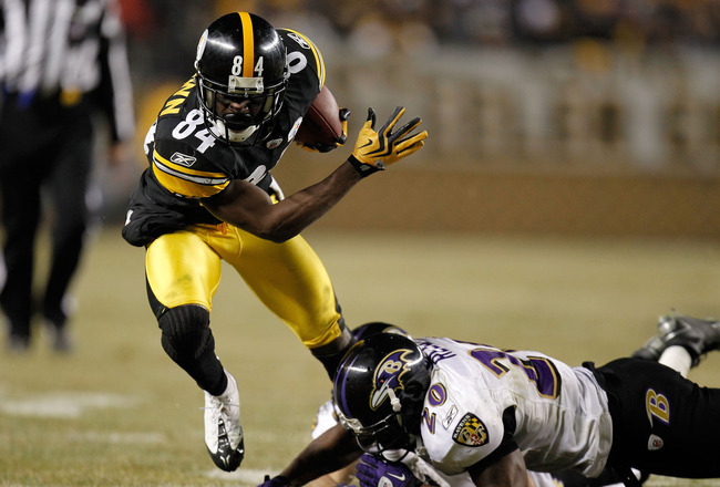 PITTSBURGH, PA - JANUARY 15:  Wide receiver Antonio Brown #84 of the Pittsburgh Steelers runs with the ball after a catch against the Baltimore Ravens in the AFC Divisional Playoff Game at Heinz Field on January 15, 2011 in Pittsburgh, Pennsylvania.  (Pho