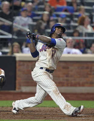 NEW YORK, NY - JUNE 18:  Jose Reyes #7 of the New York Mets hits a single against the Los Angeles Angels of Anaheim during their game on June 18, 2011 at Citi Field in the Flushing neighborhood of the Queens borough of New York City.  (Photo by Al Bello/G
