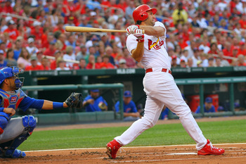 ST. LOUIS, MO - JUNE 3: Lance Berkman #12 of the St. Louis Cardinals hits a three-run home run against the Chicago Cubs at Busch Stadium on June 3, 2011 in St. Louis, Missouri.  (Photo by Dilip Vishwanat/Getty Images)