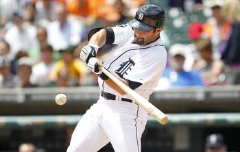DETROIT - JUNE 12: Alex Avila #13 of the Detroit Tigers singles to center field scoring teammate Miguel Cabrera #24 in the second inning during the game against the Seattle Mariners at Comerica Park on June 12, 2011 in Detroit, Michigan.  (Photo by Leon H