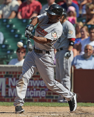 CHICAGO, IL - JUNE 01:  Michael Bourn #21 of the Houston Astros hits the ball against the Chicago Cubs at Wrigley Field on June 1, 2011 in Chicago, Illinois. The Astros defeated the Cubs 3-1.  (Photo by Jonathan Daniel/Getty Images)