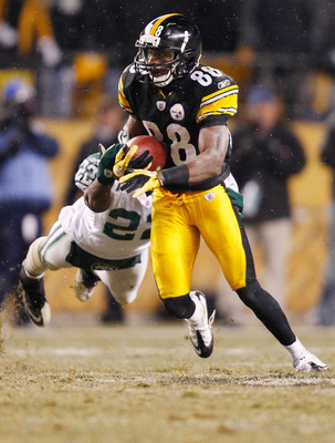 PITTSBURGH - DECEMBER 19:  Emmanuel Sanders #88 of the Pittsburgh Steelers evades a diving tackle by Brodney Pool #22 of the New York Jets during the game on December 19, 2010 at Heinz Field in Pittsburgh, Pennsylvania.  (Photo by Jared Wickerham/Getty Im