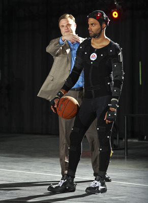 BURNABY, CANADA - JULY 29: In this photo provided by Electronic Arts, Houston Rockets General Manager Daryl Morey (L) instructs Tony Parker of the San Antonio Spurs during a motion capture session at the Electronic Arts studios July 29, 2008 in Burnaby, B
