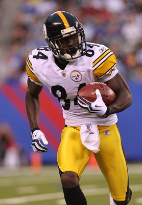 EAST RUTHERFORD, NJ - AUGUST 21:  Antonio Brown #84 of the Pittsburgh Steelers returns a kick off against the New York Giants during their preseason game at New Meadowlands Stadium on August 21, 2010 in East Rutherford, New Jersey.  (Photo by Nick Laham/G