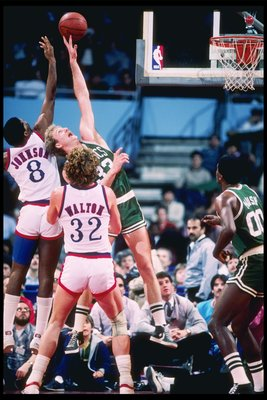 Jan 1985:  Forward Larry Bird of the Boston Celtics and forward Marique Johnson of the Los Angeles Clippers fight for a rebound during a game at the Los Angeles Sports Arena in Los Angeles, California.   Mandatory Credit: Allsport  /Allsport