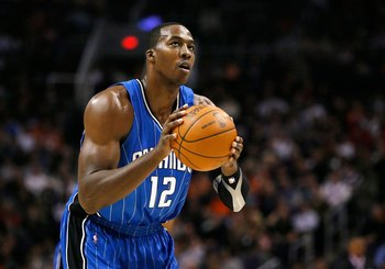 PHOENIX - DECEMBER 11:  Dwight Howard #12 of the Orlando Magic shoots a free throw shot during the NBA game against the Phoenix Suns at US Airways Center on December 11, 2009 in Phoenix, Arizona. The Suns defeated the Magic 106-103.  NOTE TO USER: User ex
