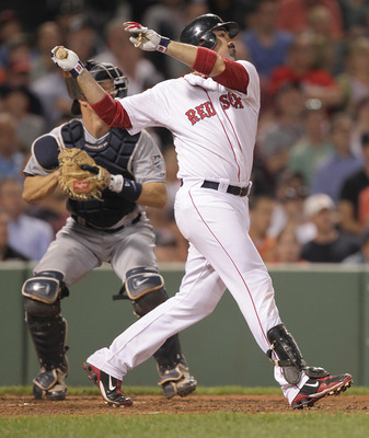 BOSTON, MA  - JUNE 20:  Adrian Gonzalez #28 of the Boston Red Sox connects for a one-run double against the San Diego Padres at Fenway Park on June 20, 2011 in Boston, Massachusetts.  (Photo by Jim Rogash/Getty Images)