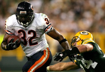GREEN BAY, WI - OCTOBER 7:  Cedric Benson #32 of the Chicago Bears tries to elude Aaron Kampman #74 of the Green Bay Packers at Lambeau Field October 7, 2007 in Green Bay Wisconsin.  (Photo by Matthew Stockman/Getty Images)