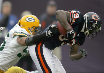 CHICAGO - JANUARY 2: Linebacker Nick Barnett #56 of the Green Bay Packers brings down wide receiver David Terrell #83 of the Chicago Bears on January 2, 2005 at Soldier Field in Chicago, Illinois. (Photo by Jonathan Daniel/Getty Images)