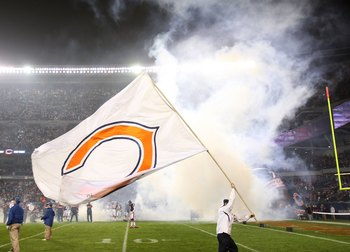 CHICAGO - NOVEMBER 22: A worker waves a Chicago Bear flag during player introductions before a game between the Bears and the Philadelphia Eagles at Soldier Field on November 22, 2009 in Chicago, Illinois. The Eagles defeated the Bears 24-20. (Photo by Jo